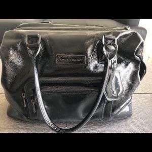 Longchamp black textured patent leather handbag.
